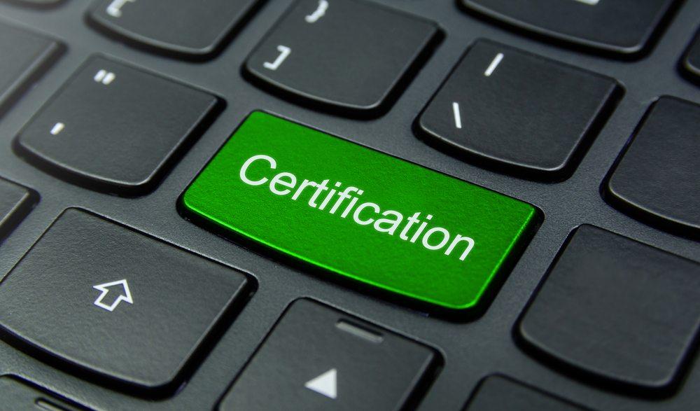 Keyboard with green certification key.
