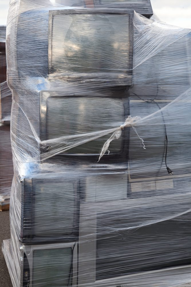 Wrapped TVs / Huguette Roe, Shutterstock