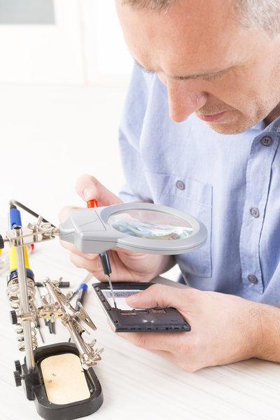 device repair / Monika_Wisniewska, Shutterstock