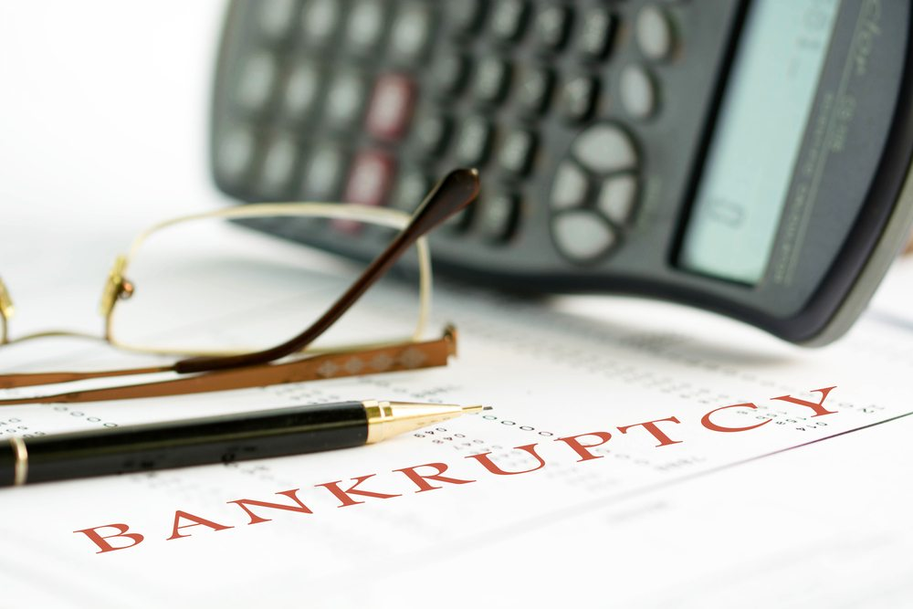 Bankruptcy paperwork with calculator.