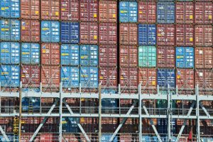 Shipping container stacked at a port.