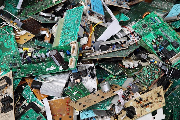 A pile of e-scrap circuit boards for recycling.
