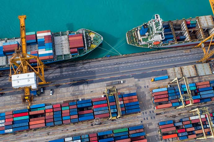 Cargo terminal with ships and containers from above.