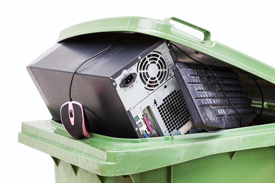 Electronics collected for recycling in a bin.