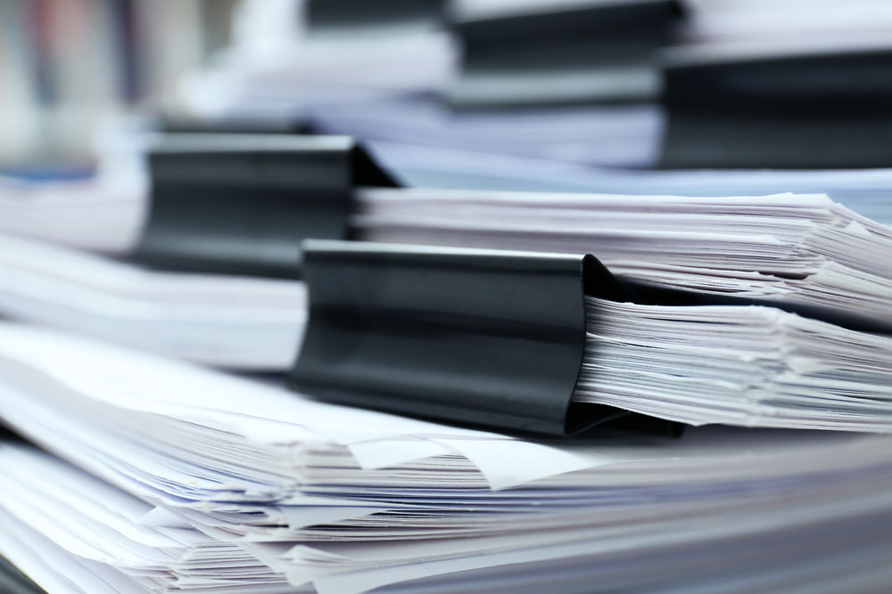 A pile of documents stacked together.