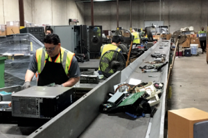 Workers at the CompuCycle e-scrap processing facility.
