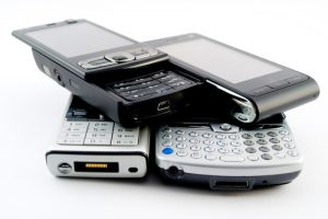 A stack of old mobile phones for recycling.