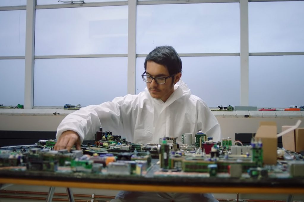 Artist with area of London crafted from e-scrap.
