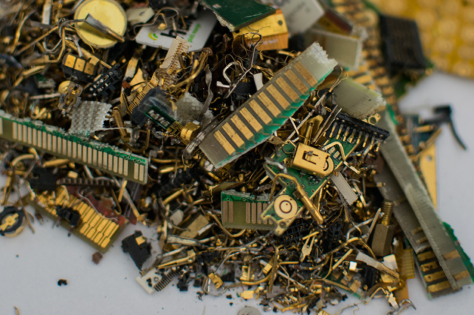 Shredded e-scrap showing gold and other metals.