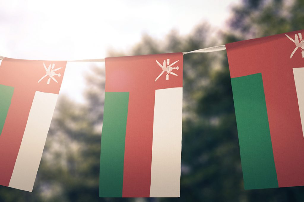 Oman flags hanging outside.