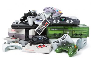 Video game systems and controllers gathered for recycling.