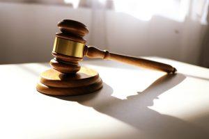 A court gavel on a desk.
