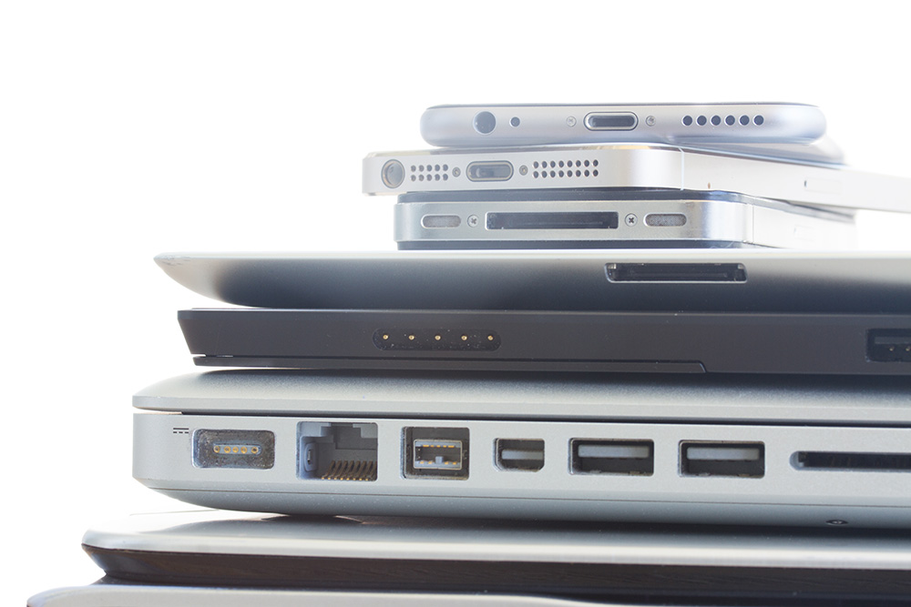 A stack of laptops and mobile devices.