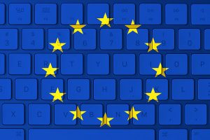 E.U. flag with a keyboard background.