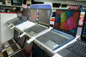 Laptops displayed at an electronics store.