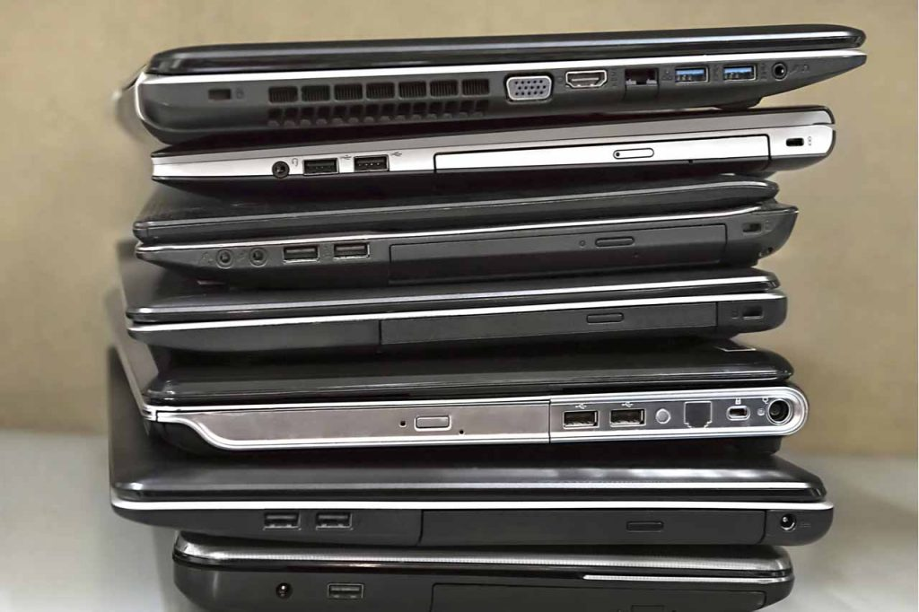 Stacked laptops for resale.