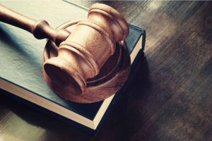 Court gavel on a book.