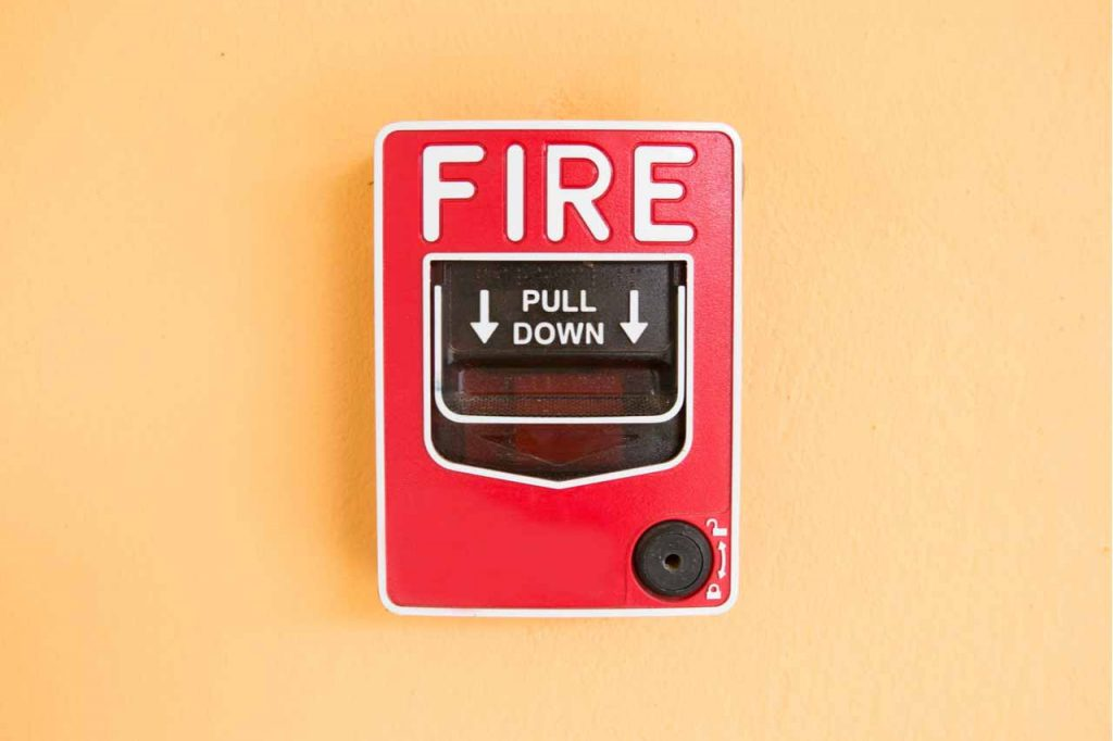 Fire alarm on a wall.