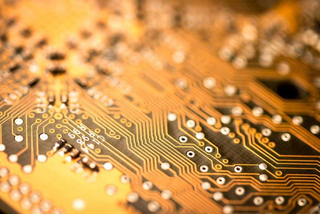 Closeup of a gold circuit board.