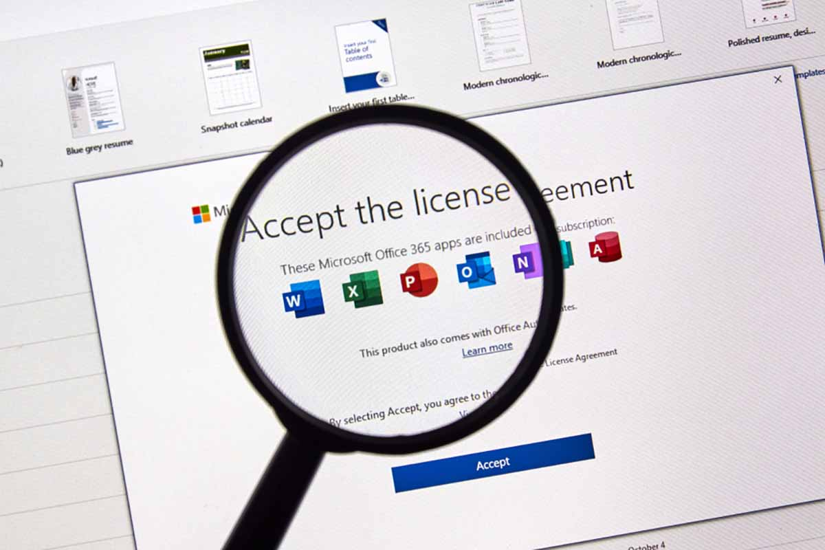 Microsoft Office license agreement screen under a magnifying glass.