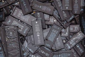 A pile of iPhone lithium-ion batteries for recycling.
