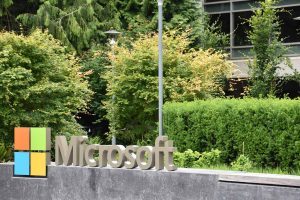 Microsoft sign in front of corporate offices.