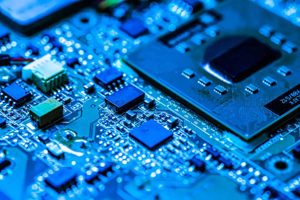 Close up of a circuitboard in blue light.