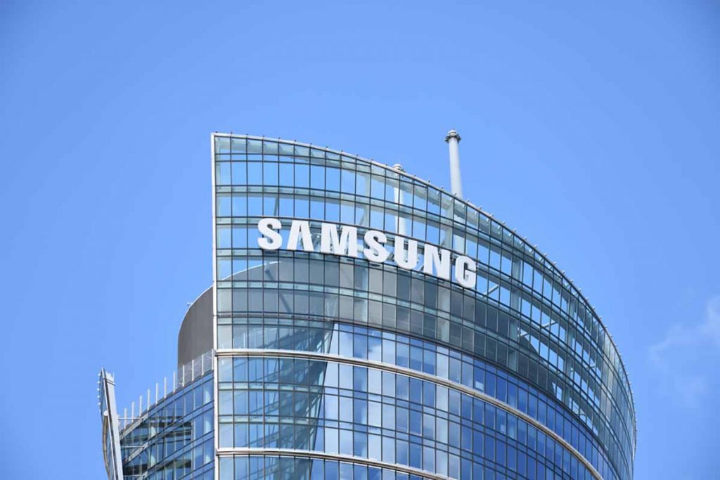 Samsung company sign on building with blue sky background.