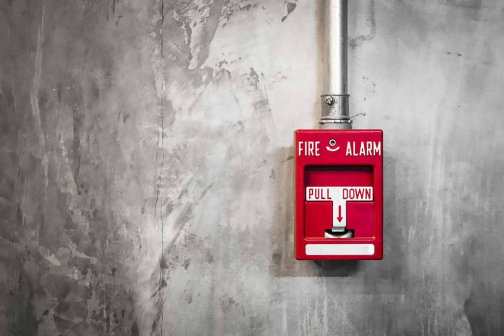 Fire alarm on a facility wall.