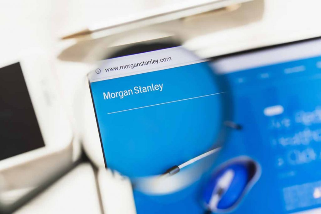 Morgan Stanley company logo on screen under magnifying glass.