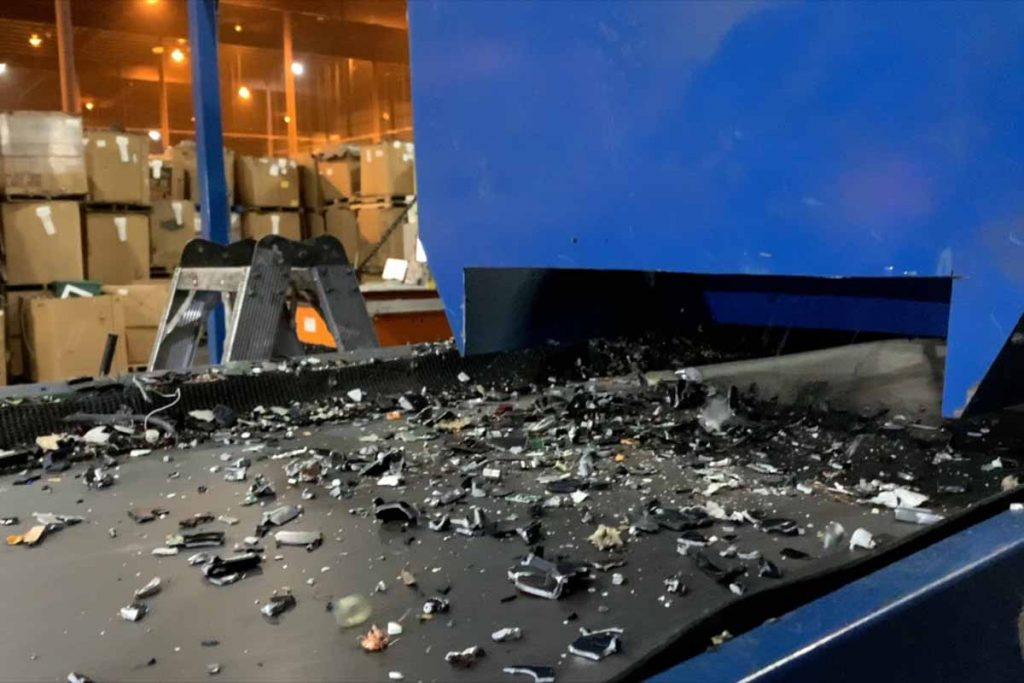 Shredded material on a conveyor at Sunnking.