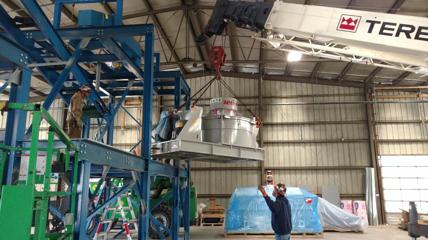 Grinder lowered into place, Momentum Recycling