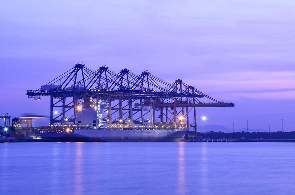 Cargo ship docked at port.