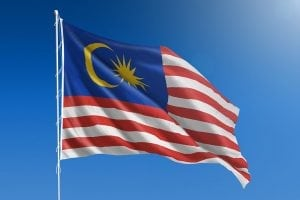 Malaysian flag with blue sky background.