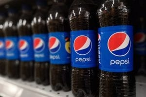 Pepsi bottles on a retail shelf.