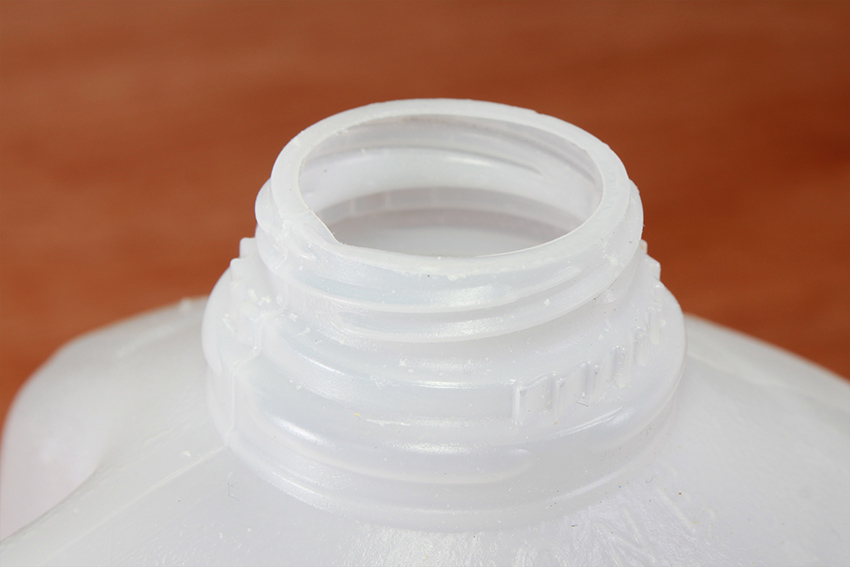 Close up of an empty plastic milk jug.