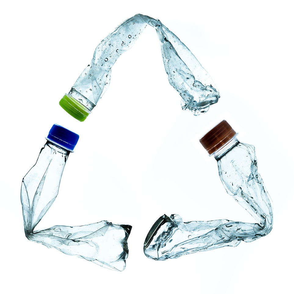 PET bottles arranged in a recycling symbol.