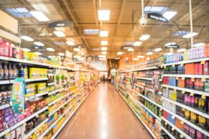 Blurred view of a grocery store aisle.