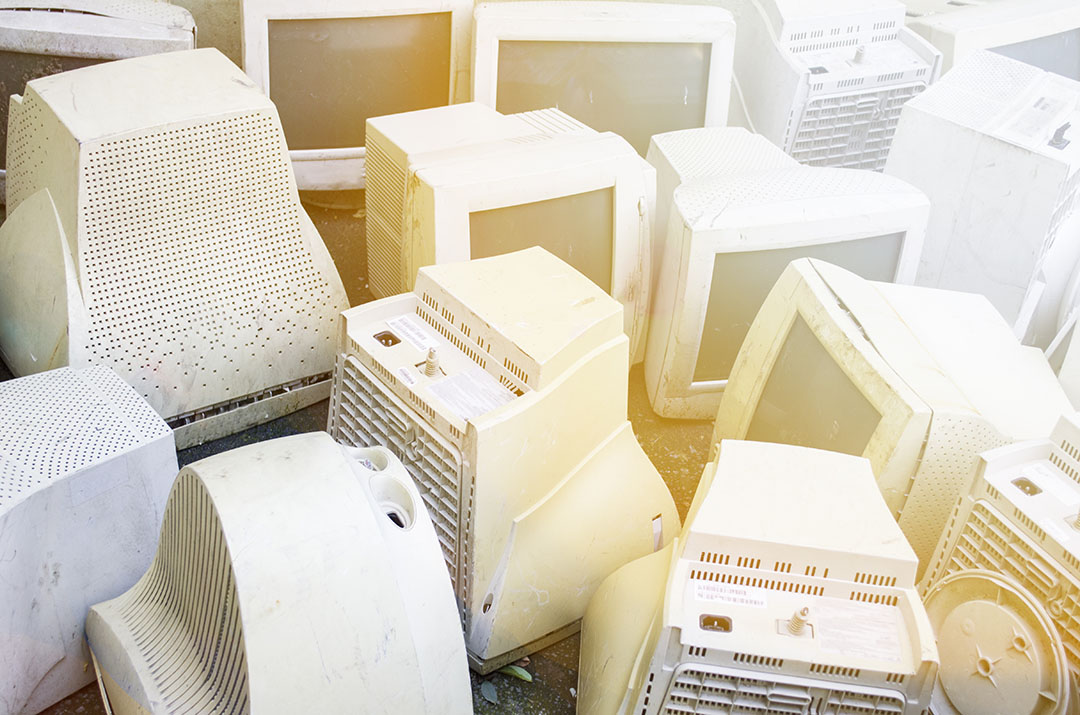 CRT computer monitors gathered for recycling.