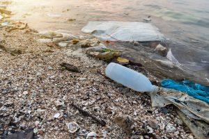 Plastics littering an ocean beach.