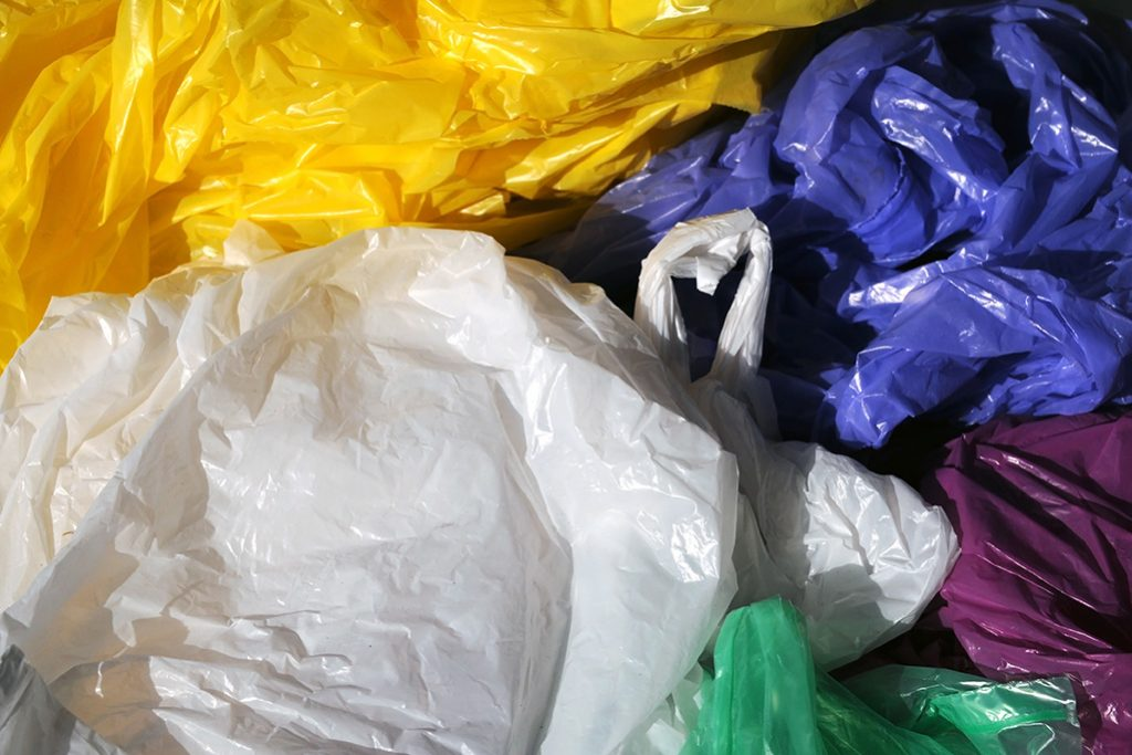 Colorful plastic shopping bags gathered for recycling.
