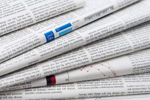 Closeup of stacked newspapers.