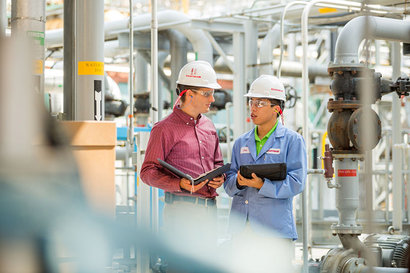 Employees inside an Eastman facility.