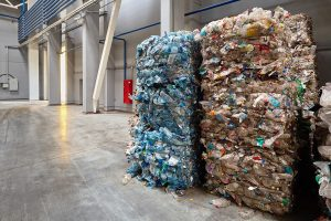 Baled plastics in a recycling facility.
