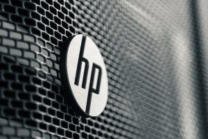 Closeup of a metallic HP logo.