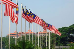 A row of Malaysian flags outside.