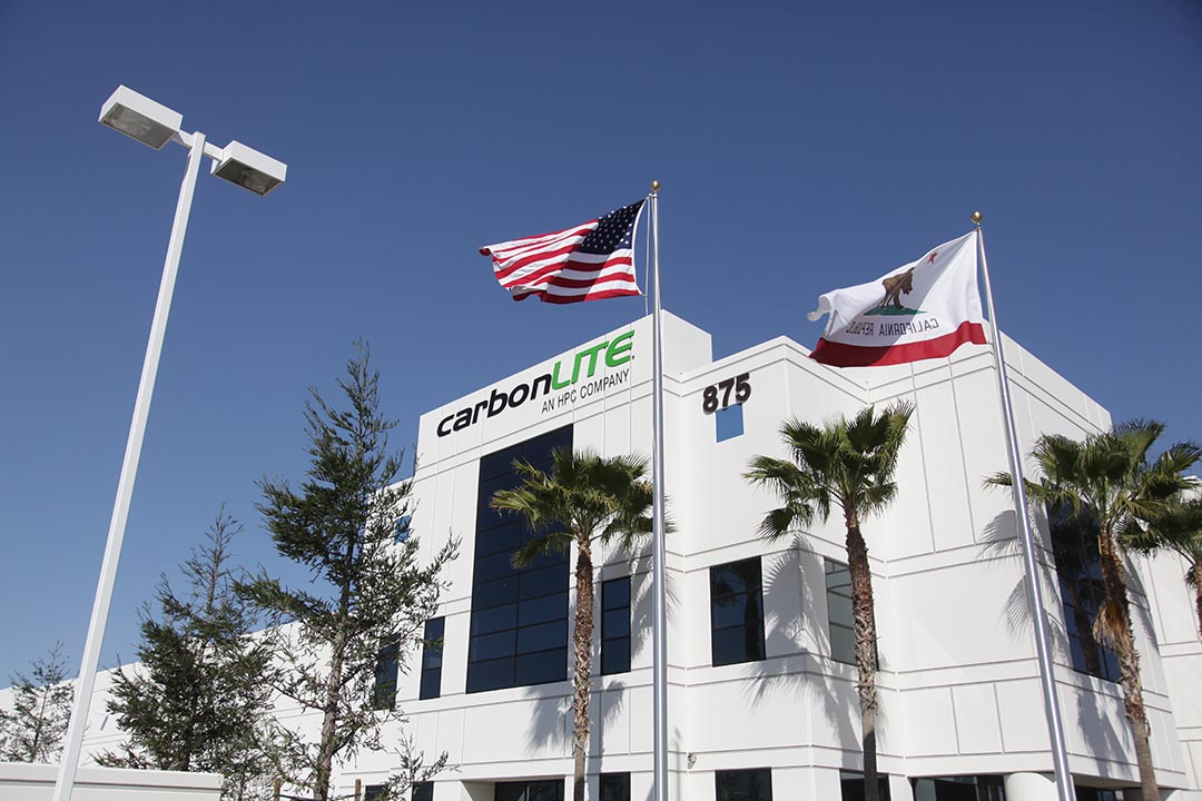 CarbonLite Facility exterior with California and U.S. flags.