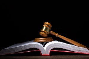 A court gavel on an open book.