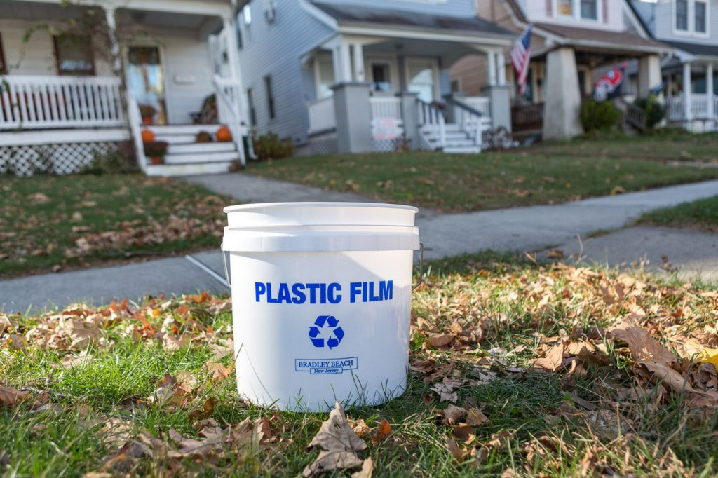 Curbside plastic film collection bucket.
