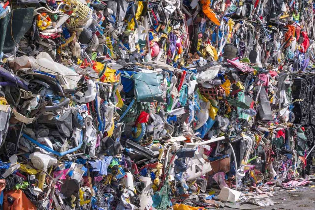 Closeup of bales of mixed plastics for recycling.